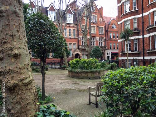 A little garden off Gilbert Street in Mayfair, London Canvas Print