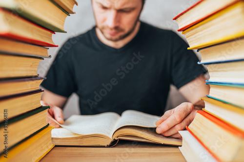 An avid reader - a grown man flips through pages of an old dusty book between st Tapéta, Fotótapéta