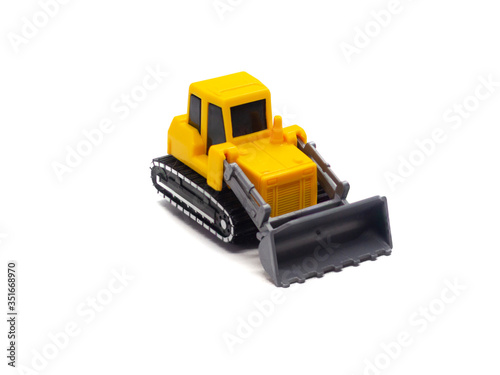 Toy orange yellow dozer small isolated on the white background