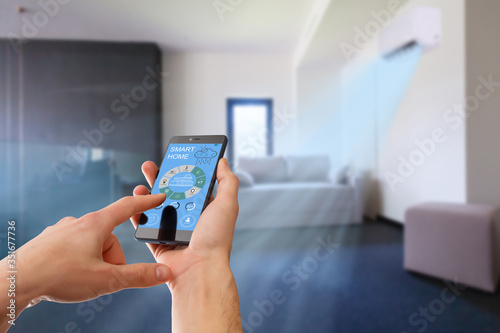 Air conditioner remote control with smart home system on digital device Canvas Print
