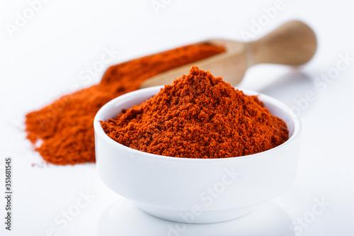 Canvas fragrant ground paprika on a white acrylic background