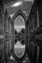 Reflection Of Bolton Abbey In Canal Against Galaxy At Dusk