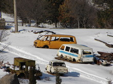 Abandoned Cars At Snow Covered Junkyard During Winter