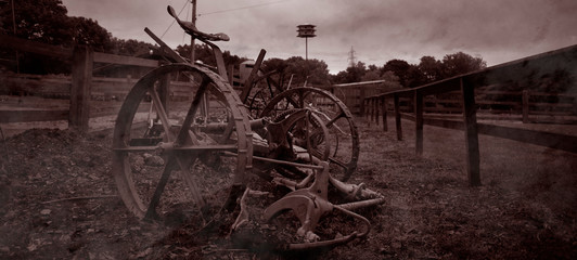 Fototapeta na wymiar Abandoned Vehicle On Field Against Sky