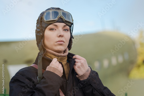 Fotografija A young female pilot in uniform of Soviet Army pilots during the World War II