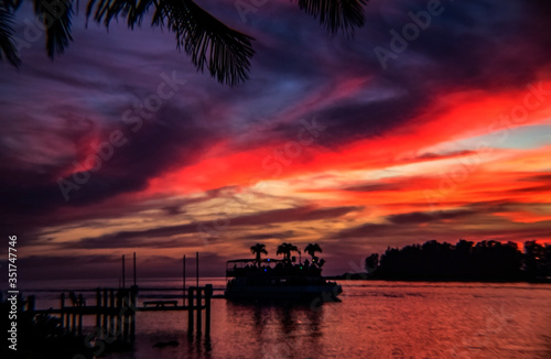 sunset over the sea, red, sky, water, boat, landscape, horizon, dusk, vibrant, colorful, Siesta Key, Florida