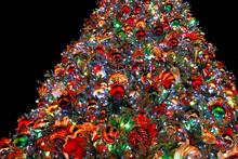 Low Angle View Of Illuminated Christmas Tree At Night
