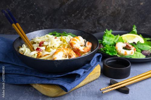 Stir fry noodles with vegetables and shrimps in bowl. Wallpaper Mural