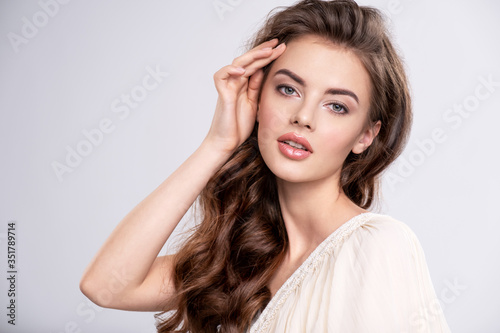 Obraz Portrait of a young beautiful woman with a long hair. - fototapety do salonu