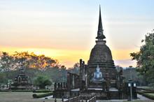 Buddha Statue At Sukhothai Historical Park Against Sky