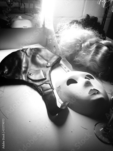 Valokuva Mask By Helmet And Wig On Dressing Table