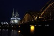 Low Angle View Of Illuminated Hohenzollern Bridge Over River By Cologne Cathedral