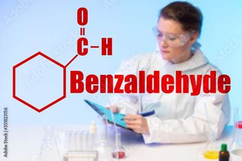 Girl chemist in the laboratory against the background of the molecular formula and the inscription Benzaldehyde Canvas Print