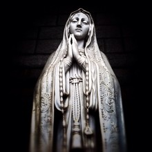 Low Angle View Of Virgin Mary Statue Against Wall