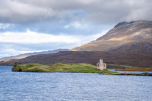 Ardvreck Castle, Loch Assynt In The Dramatic Highlands Of Scenic Scotland, A Fantastic Adventure Travel Destination For A Holiday Vacation To View Awesome Picturesque Scenery Especially At Sunrise Or