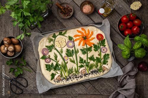 Obraz raw floral painting focaccia,  garden flatbread art, food trend - fototapety do salonu