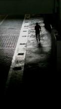 Lone Person On Sidewalk