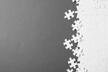 Blank White Puzzle Pieces On Grey Background, Flat Lay. Space For Text