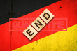 canvas print picture - End of quarantine. The inscription on wooden blocks on the background of the flag of Germany. The end of the pandemic. Business.
