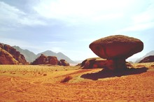 Rock Formations In Desert Agai...