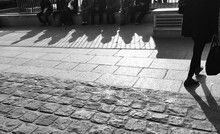 People Sitting In Street