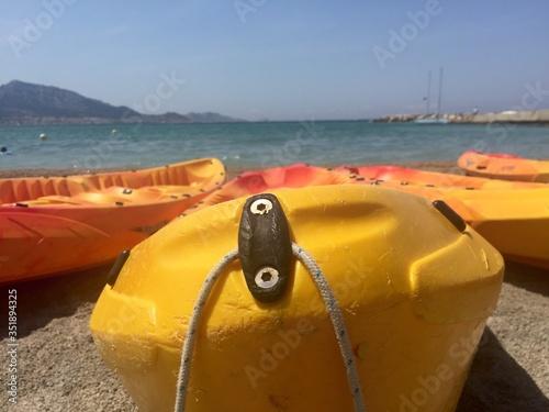 Photo Yellow Canoes At Sandy Beach