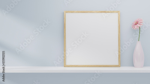 Obraz A blank picture and poster frame set on a shelf on the wall. - fototapety do salonu