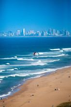 Early Morning Beach And Sea Against Blue Sky And City Skyline In In Umhlanga, Durban, South Africa