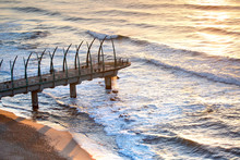 View Of The Indian Ocean Through The Millennium Pier In Umhlanga Rocks At Sunrise. Durban, South Africa.