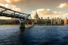 Millennium Bridge And St Pauls Cathedral Against Sky In City