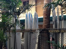 Surfboards By Fence Against House