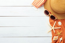 Summer Background With Beach Accessories - Straw Hat, Sunglasses, Towel And Mask To Prevent Covid-19 On White Wood Table Background Top View With Copy Space.
