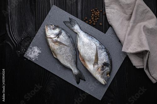 Fototapeta Dorada on a gray board, dark background obraz