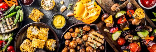 Obraz Assortment various barbecue vegan food, set of grill veggies, vegetable bbq party fest, grilled corn, vegan skewers kebabs, hot vegetable salad, with sauces & spices. Vegetarian seasonal summer food - fototapety do salonu