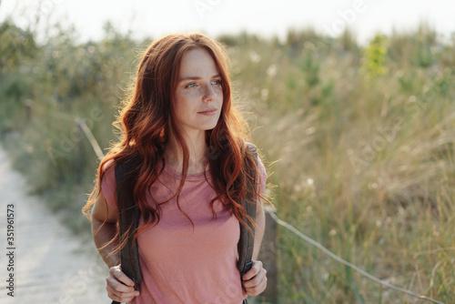 Young woman hiking through coastal dunes Canvas