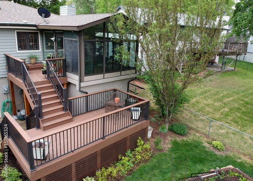 Obraz Remodeled home with sunroom and composite deck - fototapety do salonu