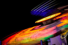 Low Angle View Of Illuminated Amusement Park Ride Against Clear Sky At Night