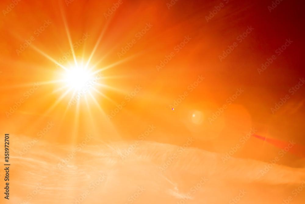 Fototapeta Orange sky with bright sun symbolizing climate change and global warming