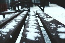 Close-up Of Snow On Metallic Bench