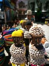 Close-up Of Sculptures At Market For Sale