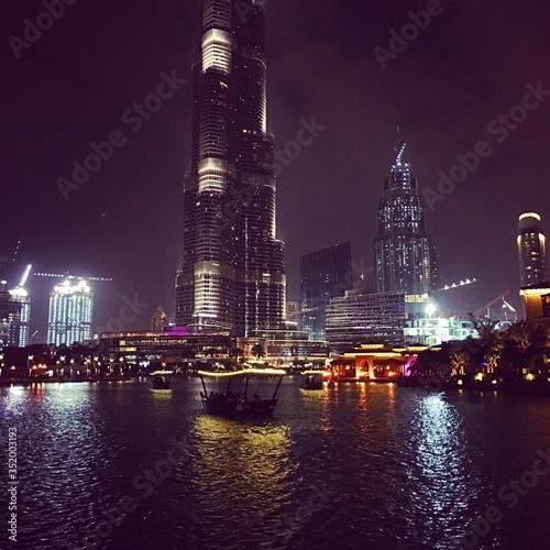 Obraz na plátně Illuminated Burj Khalifa By Sea In City At Night