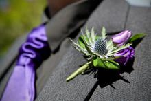 Purple Flower On Suit Of Groom