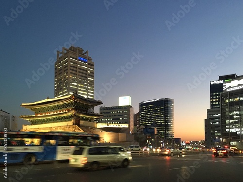 Illuminated Namdaemun Gate In Front Of Road Against Clear Sky At Dusk In City Fototapete