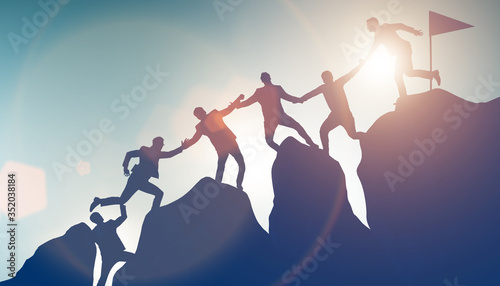 Fototapeta Concept of teamwork with team climbing mountain top obraz