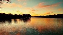 Scenic View Of Lake Pampulha Against Sky During Sunset