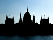 River In Front Of Silhouette Hungarian Parliament Building Against Clear Sky