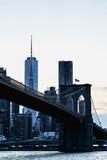 Fototapeta Most - New York night panorama. Brooklyn Bridge and New York City skyline. Manhattan skyline. Skyscrapers buildings. New York City night lights.