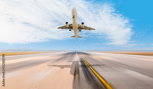 White Passenger plane fly up over take-off runway from airport Wallpaper Mural
