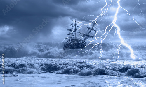 Fototapeta Sailing old ship in storm sea on the background heavy clouds with lightning