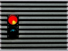 Close-up Of Road Signal Against Wall
